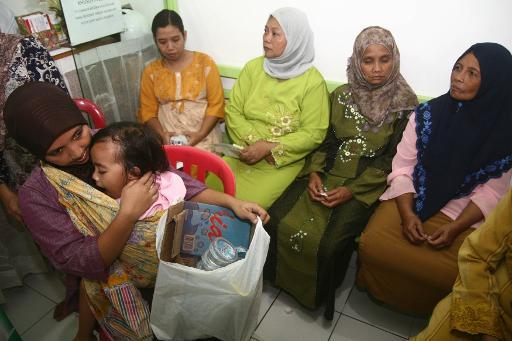 888381466_en_indonesie_les_pauvres_troquent_des_dechets_